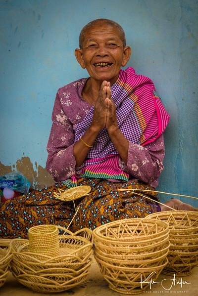This village elder demonstrates traditional basket making.