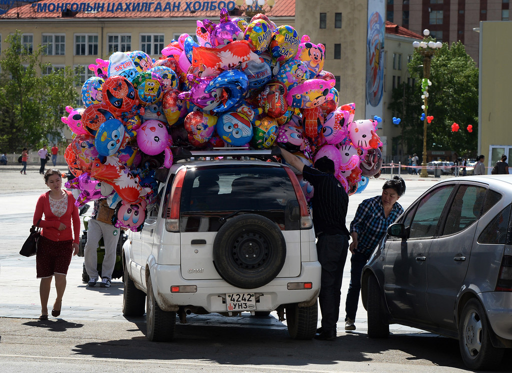 . A car carrying balloons for sale arrives at Sukhbaatar Square in Ulan Bator, Mongolia on June 2, 2013. The country is in the middle of a resources boom with the huge copper and gold Oyu Tolgoi soon to open and which will provide vast revenues for the government that can be spent on infrastructure and education if corruption can be kept in check. MARK RALSTON/AFP/Getty Images