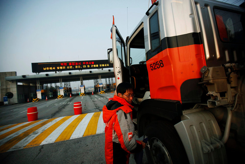 . A South Korean truck driver leaves his truck as he waits to enter the Kaesong industrial complex in North Korea, at the South\'s Customs, Immigration and Quarantine (CIQ) area, just south of the demilitarized zone separating the two Koreas, in Paju, north of Seoul, April 4, 2013. North Korea closed access to a joint factory zone with South Korea on Wednesday, officials said, putting at risk $2 billion a year in trade that is vital for an impoverished state with a huge army, nuclear ambitions and a hungry population. REUTERS/Kim Hong-Ji