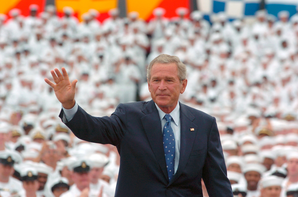 . With a sea of Navy sailors behind him, President Bush waves to the crowd after finishing his speech at the Naval Base Coronado during his visit to Coronado, Calif., Tuesday, Aug. 30, 2005. Bush assured thousands of Navy sailors, officers and Marine troops that America would not rest until it defeats the enemy that attacked on Sept. 11, 2001. (AP Photo/Hayne Palmour IV, Pool)