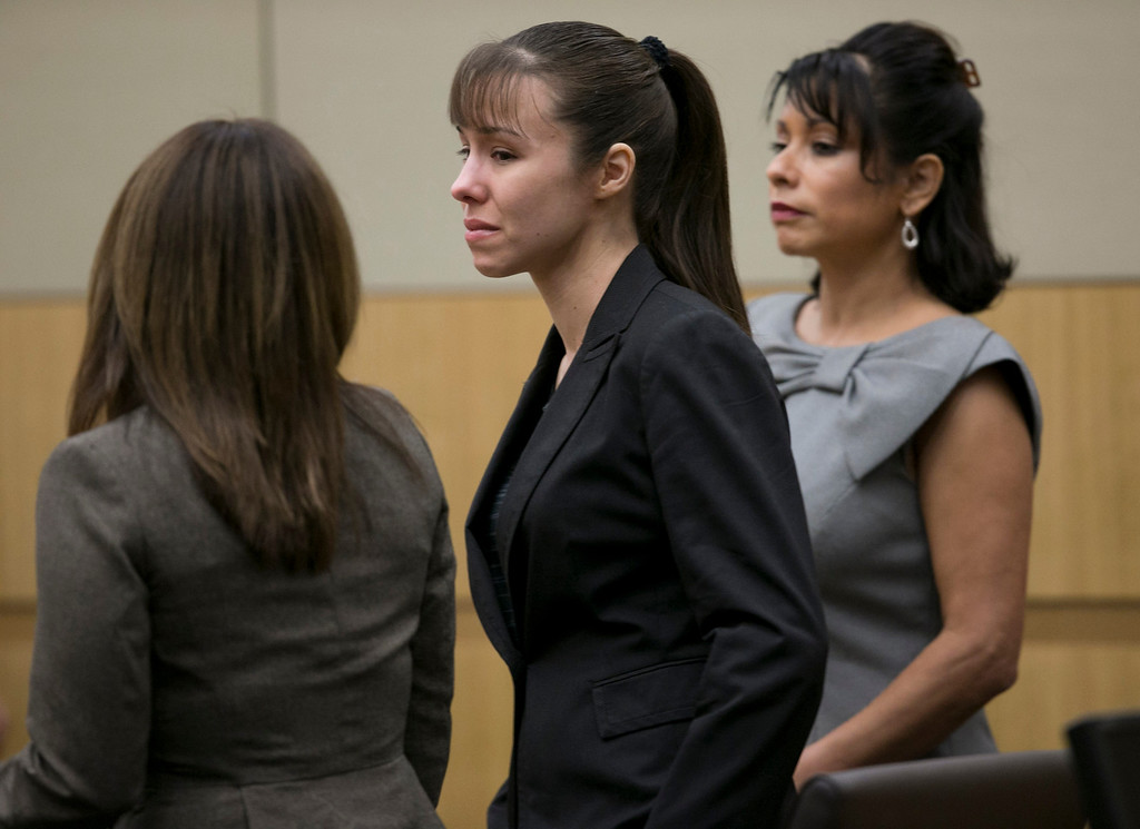 . Jodi Arias stands as the jury is excused after the verdict for sentencing was declared a hung jury for her first degree murder conviction at Maricopa County Superior Court in Phoenix, Ariz., on Thursday, May 23, 2013. (AP Photo/The Arizona Republic, David Wallace, Pool)