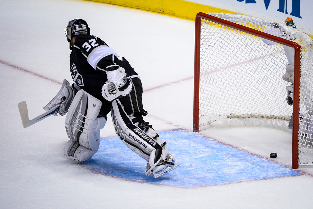 . Kings Jonathan Quick lets this shot get by on during a Kings power play during first period action at Game 1 of the Stanley cup Finals at Staples Center Wednesday, June 4, 2014 ( Photo by David Crane/Los Angeles Daily News )