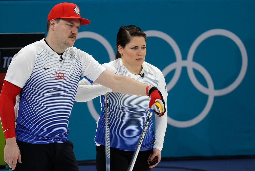 . United States\' siblings Matt and Becca Hamilton for their turn during the mixed doubles curling match against Finland at the 2018 Winter Olympics in Gangneung, South Korea, Sunday, Feb. 11, 2018. (AP Photo/Aaron Favila)