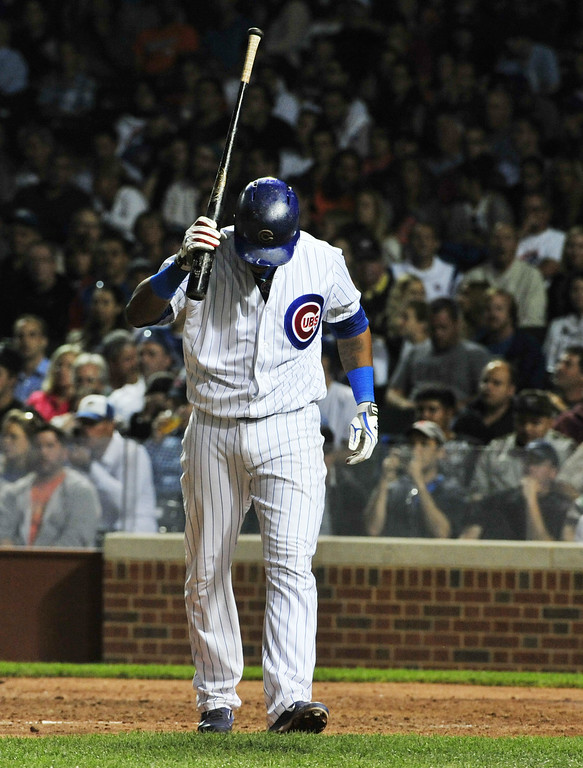 . CHICAGO, IL - JULY 30:  Starlin Castro #13 of the Chicago Cubs reacts after striking out against the Colorado Rockies during the sixth inning on July 30, 2014 at Wrigley Field in Chicago, Illinois. (Photo by David Banks/Getty Images)