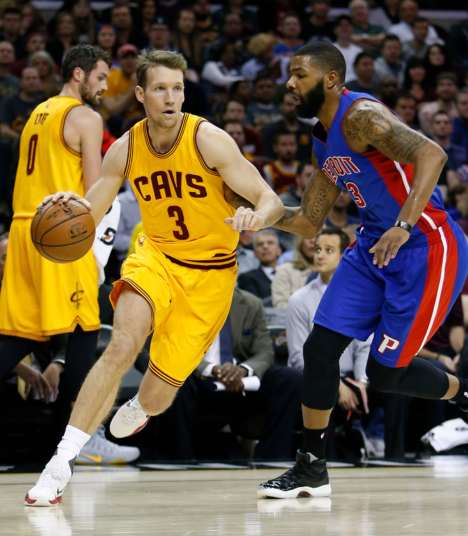 . Cleveland Cavaliers\' Mike Dunleavy (3) drives around Detroit Pistons\' Marcus Morris (13) during the first half of an NBA basketball game Friday, Nov. 18, 2016, in Cleveland. The Cavaliers won 104-81. (AP Photo/Ron Schwane)