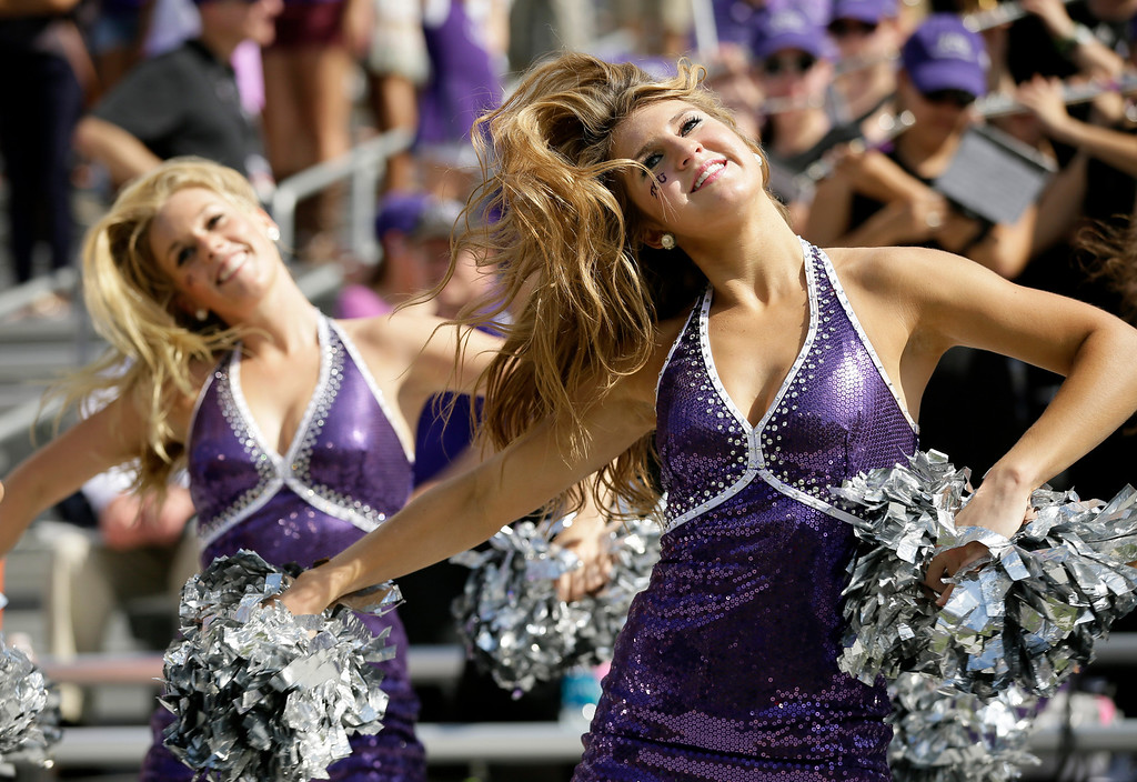 . Members of the TCU Show Girls perform during the first half of an NCAA college football game against Kansas, Saturday, Oct. 12, 2013, in Fort Worth, Texas. (AP Photo/Tony Gutierrez)
