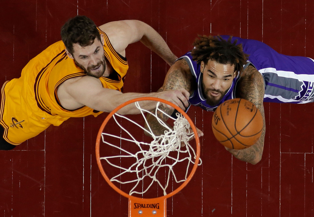 . Cleveland Cavaliers\' Kevin Love, left, and Sacramento Kings\' Willie Cauley-Stein go up for a rebound during the second half of an NBA basketball game, Wednesday, Jan. 25, 2017, in Cleveland. The Kings won 116-112 in overtime. (AP Photo/Tony Dejak)