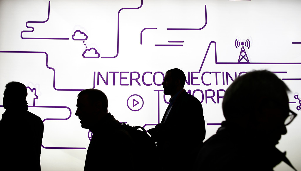 . Visitors attend the Mobile World Congress wireless show, in Barcelona, Spain, Tuesday, Feb. 27, 2018. The annual Mobile World Congress (MWC) runs from 26 February - 1 March and draws over 2,300 exhibitors to Barcelona, including industry heavyweights Samsung, Huawei and Nokia. (AP Photo/Manu Fernandez)