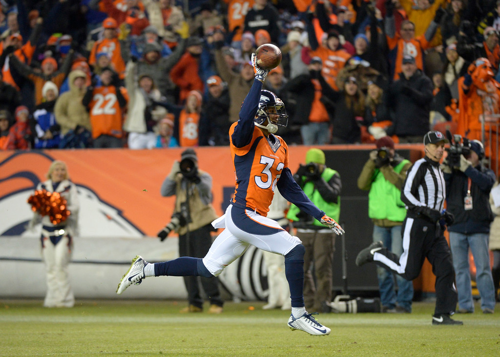 . DENVER, CO - DECEMBER 28: Tony Carter (32) of the Denver Broncos recovers a fumble and runs into the end zone for a touchdown during the fourth quarter. The Denver Broncos played the Oakland Raiders at Sports Authority Field at Mile High in Denver on December, 28 2014. (Photo by Joe Amon/The Denver Post)