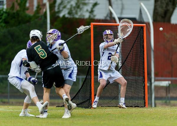 Broughton boys varsity lacrosse vs Enloe. March 10, 2020. D4S_7772