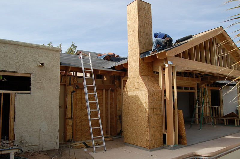 Roofing tiles going on in the back of the house.