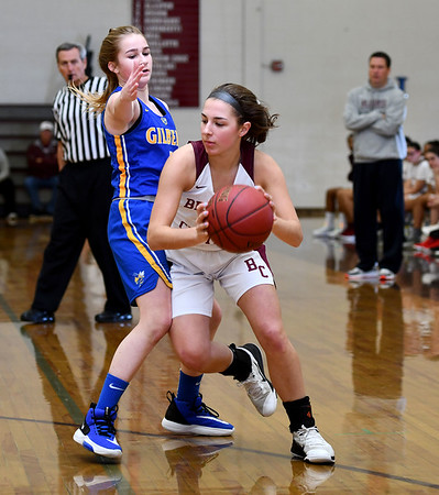 12/31/2019 MIke Orazzi | StaffrBristol Central's Gwen Torreso (20) and Gilbert's Kim McCarthy (4) during Tuesday's girls basketball game in Bristol.