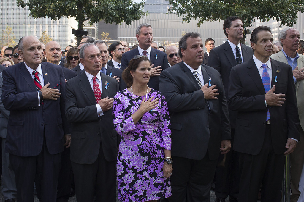 . Former New York Mayor Rudy Giuliani (L-R), New York Mayor Michael Bloomberg, New Jersey Governor Chris Christie with wife Mary Pat Christie and New York State Governor Andrew Cuomo take part in the national anthem while attending the 9/11 Memorial ceremonies marking the 12th anniversary of the 9/11 attacks on the World Trade Center on September 11, 2013 in New York City.  (Photo by Adrees Latif-Pool/Getty Images)