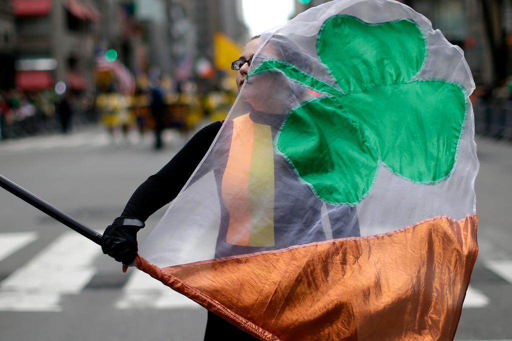 . A participant twirls a flag as she marches up Fifth Avenue during the St. Patrick\'s Day Parade, Tuesday, March 17, 2015, in New York.  (AP Photo/Mary Altaffer)