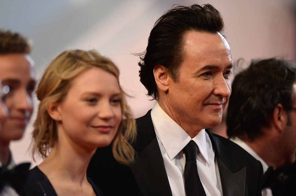 """. Mia Wasikowska (L) and John Cusack attend the \""""Maps To The Stars\"""" premiere during the 67th Annual Cannes Film Festival on May 19, 2014 in Cannes, France.  (Photo by Pascal Le Segretain/Getty Images)"""