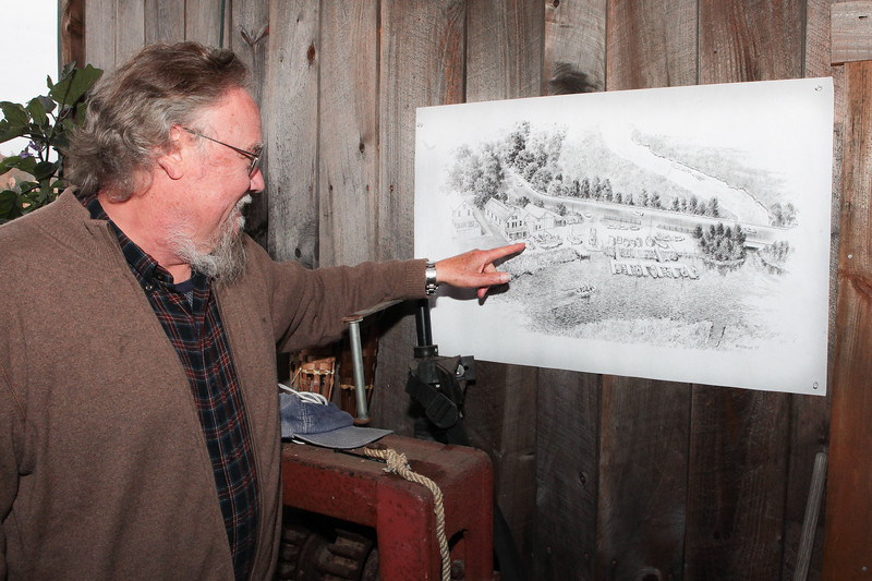 JRWA Board Member Wendell Chamberlain points out details of an artist's rendering a renovated Jones River Landing  property someday. Wicked Local Photo/Denise Maccaferri