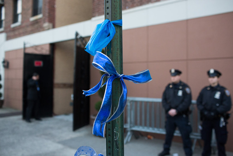 . Blue ribbons are tied to a pole ahead of the funeral of slain New York City Police Officer Rafael Ramos, one of two officers murdered while sitting in their patrol car in an ambush in Brooklyn last Saturday afternoon on December 27, 2014 in New York City. Thousands of fellow officers, family, friends and Vice President Joseph Biden are expected at the church in the Glendale neighborhood of Queens for the funeral. (Photo by Kevin Hagen/Getty Images)
