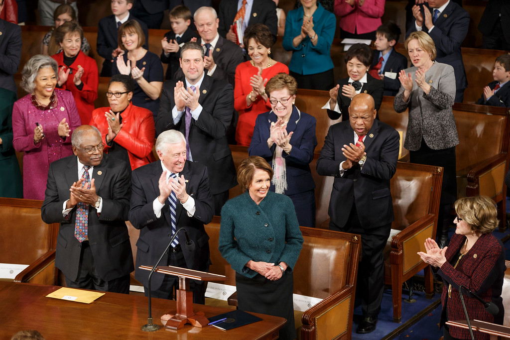 . House Minority Leader Nancy Pelosi of Calif., is applauded by Democratic members of the House of Representatives during nominations for speaker as lawmakers gather for opening session of the 114th Congress, at the Capitol in Washington, Tuesday, Jan. 6, 2015. House Speaker John Boehner, R-Ohio, won a third term despite a tea party-backed effort to unseat him. Front row, from left are, House Assistant Minority Leader James Clyburn of S.C., House Minority Whip Steny Hoyer of Md. and Pelosi. (AP Photo/J. Scott Applewhite)