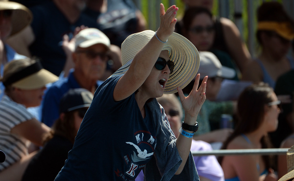 . A fan cheers on the swimmers in the 200 yard freestyle during the Division 2 CIF Southern Section Swimming Championships in the Riverside Aquatics Complex at Riverside City College in Riverside, Calif., on Saturday, May 17, 2014.  (Keith Birmingham/Pasadena Star-News)