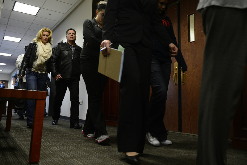 . People exit the courtroom for following a hearing for James Holmes, the accused gunman in the Aurora theater shooting, at the Arapahoe County Justice Center on Monday, January 7, 2013. AAron Ontiveroz/The Denver Post