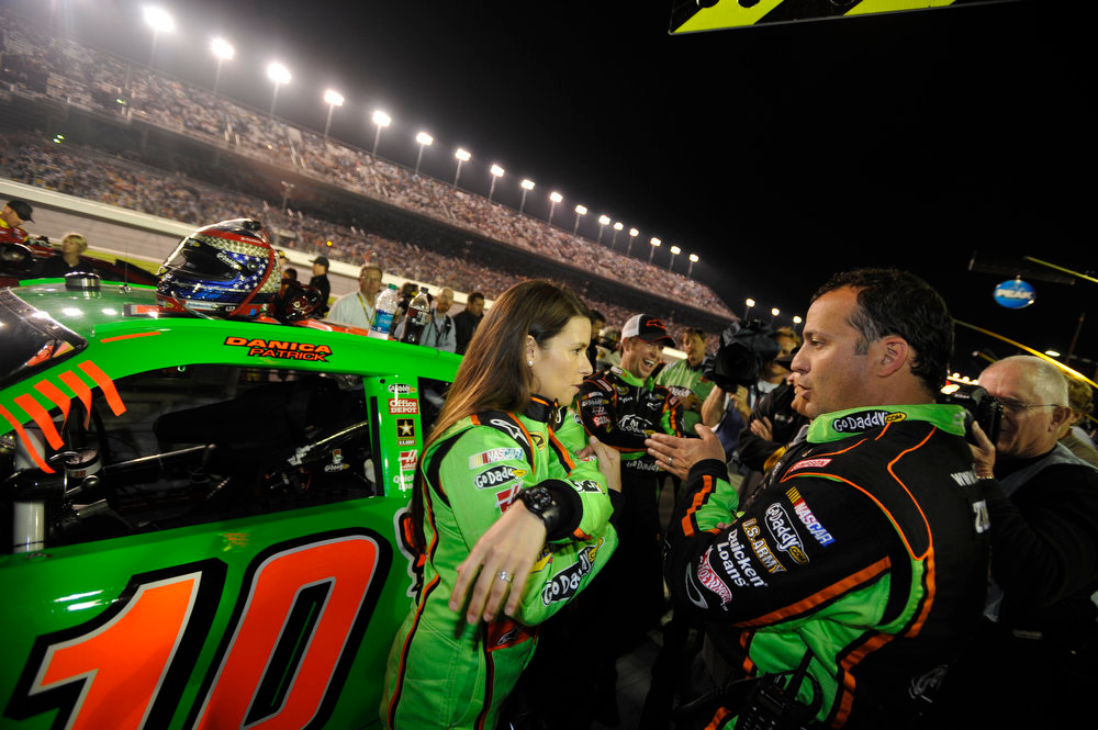 . Danica Patrick, left, talks with Greg Zipadelli, right, before the NASCAR Daytona 500 Sprint Cup series auto race at Daytona International Speedway in Daytona Beach, Fla., Monday, Feb. 27, 2012. (AP Photo/Rainier Ehrhardt)