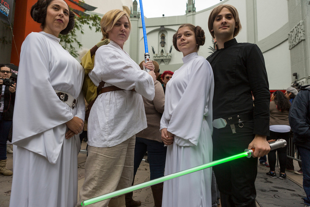 ". Costumed fans in honor of actress Carrie Fisher, who played Leia in the ""Star Wars\"" movie series, gather for a memorial for actress Carrie Fisher in the forecourt at the TCL Chinese Theatre in the Hollywood section of Los Angeles, Saturday, Dec. 31, 2016. Fisher had been hospitalized since Dec. 23 after falling ill aboard a flight and being treated by paramedics at the Los Angeles airport. One day after Fisher\'s death, her actress mother, 84-year-old Debbie Reynolds, died as well. A joint funeral for the two women has been announced. (AP Photo/Damian Dovarganes)"