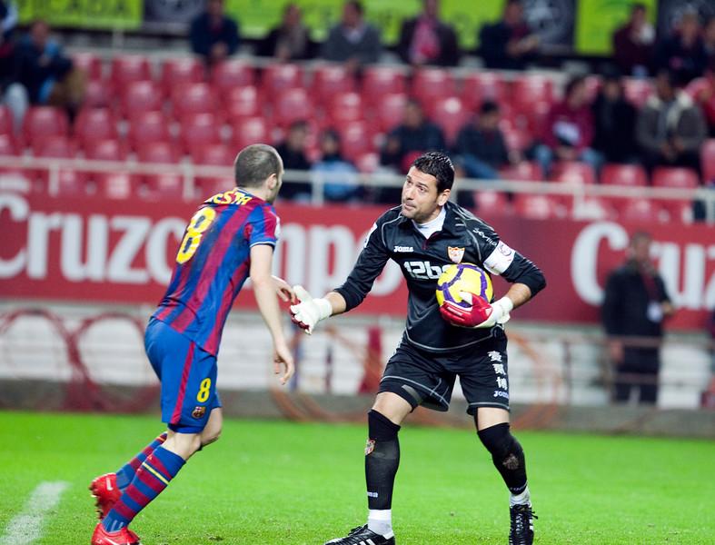 Palop and Iniesta. Spanish Cup game between Sevilla FC and FC Barcelona, Ramon Sanchez Pizjuan stadium, Seville, Spain, 13 January 2010