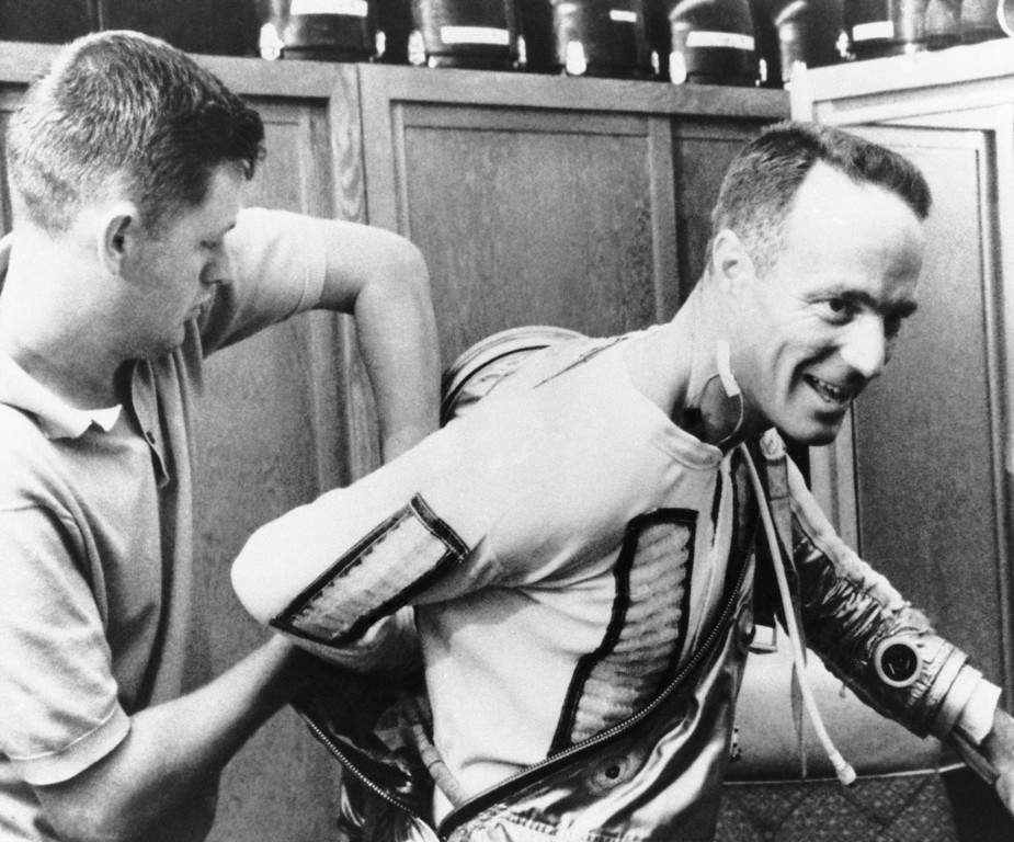 . Astronaut Scott Carpenter is assisted into his space suit by suit technician Al Rochford during preparations, May 17, 1962 at Cape Canaveral missile center for his orbital flight around the earth. Carpenter is scheduled to make a three orbit trip on Saturday. A sensor lead is taped to Carpenter?s neck. This photo was released at Cape Canaveral by the National Aeronautics and Space Administration. (AP Photo)