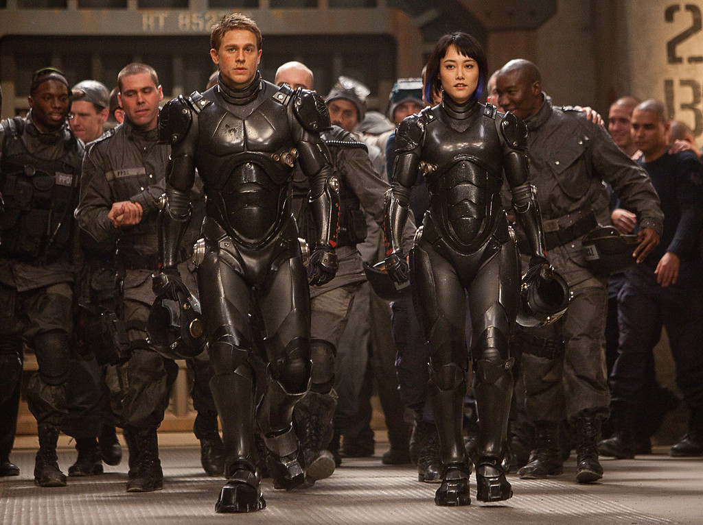 """. (Front l-r) CHARLIE HUNNAM as Raleigh Becket and RINKO KIKUCHI as Mako Mori in Warner Bros. Pictures and Legendary Pictures� sci-fi action adventure \""""PACIFIC RIM,\"""" a Warner Bros. Pictures release."""