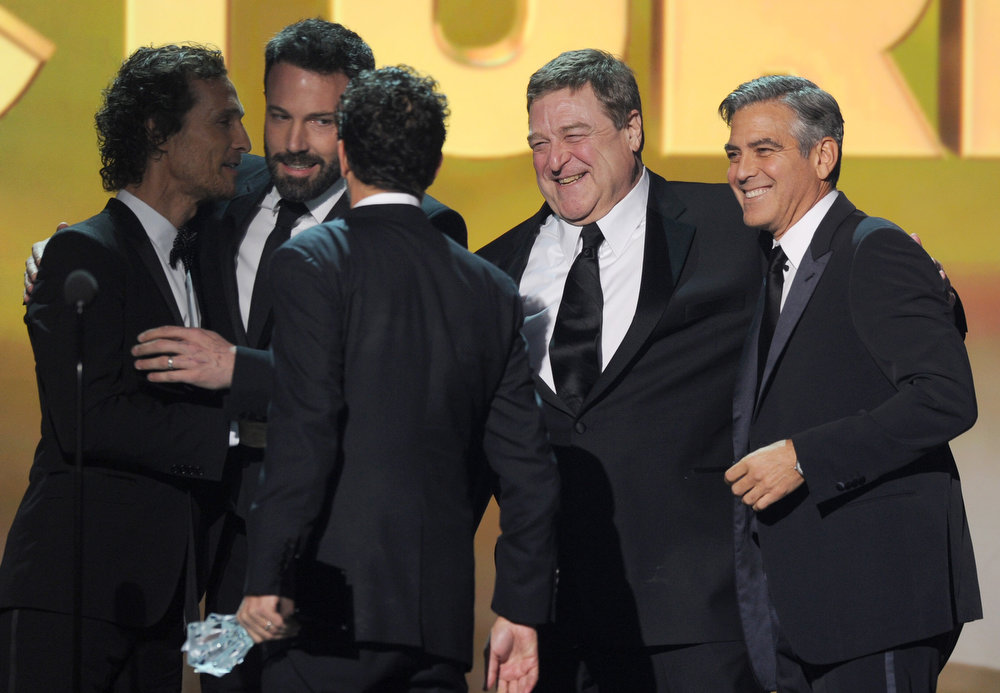 Description of . (L-R) Actor Matthew McConaughey, actor/director Ben Affleck, producer Grant Heslov, actors John Goodman and Ben Affleck onstage at the 18th Annual Critics' Choice Movie Awards held at Barker Hangar on January 10, 2013 in Santa Monica, California.  (Photo by Kevin Winter/Getty Images)