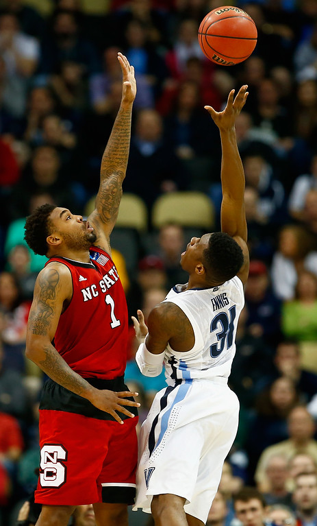 . Dylan Ennis #31 of the Villanova Wildcats puts up a shot over Trevor Lacey #1 of the North Carolina State Wolfpack in the second half during the third round of the 2015 NCAA Men\'s Basketball Tournament at Consol Energy Center on March 21, 2015 in Pittsburgh, Pennsylvania.  (Photo by Jared Wickerham/Getty Images)
