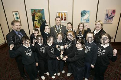 Newry Lions Club Sponsored swim awards. President William Hanna presents Cloughoge P.S. who won best overall school. 06W7N14