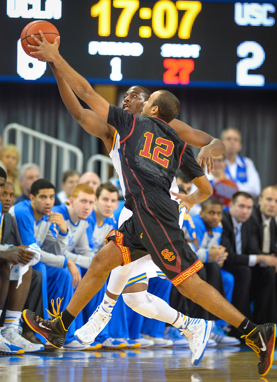 . UCLA�s David Wear and Chass Bryan go after a loose ball during game action at Pauley Pavilion Sunday, December 5, 2014. UCLA  defeated USC 107-73.  Photo by David Crane/Los Angeles Daily News.