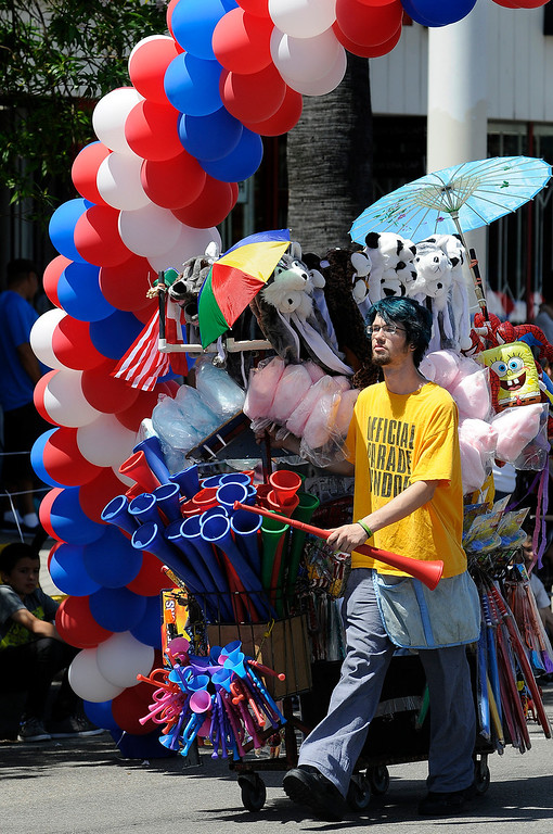 . Street Vendor Eric Stone makes shows off his wares. The Annual Canoga Park Memorial Day Parade marched down Sherman Way from Owensmouth east to Mason Street where it concluded at the First Baptist Church. Canoga park, CA 5/27/2013(John McCoy/LA Daily News)