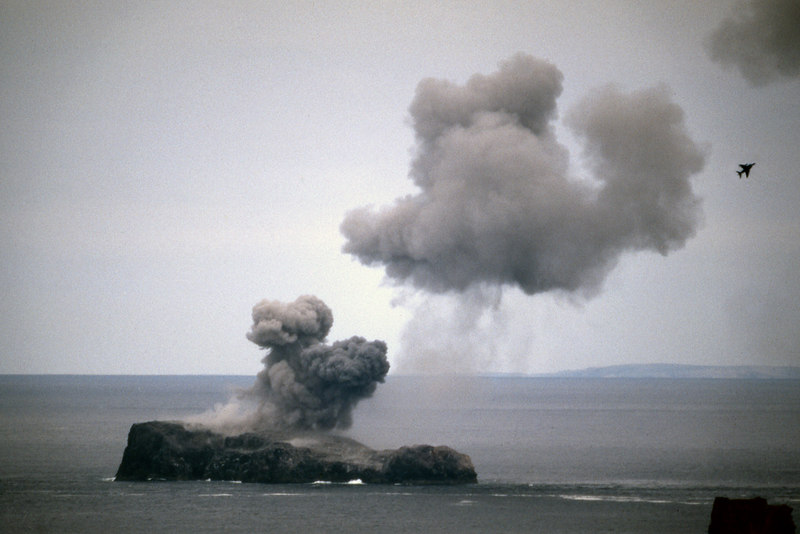 Garbh-eilean - NATO exercise off the NW coast.  1pm, 17/6/88  Officially the Parph was closed, with sentries on the road, but I'd sneaked round on the blind side from Sandwood. Watching the bombardment of poor old Garbh-eilean was somewhere between stirring and shocking. This photo was taken from a respectful distance, with a 500mm lens.