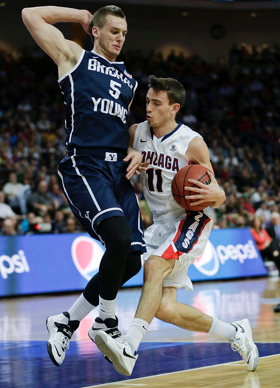 . Gonzaga\'s David Stockton (11) drives against BYU\'s Kyle Collinsworth (5) in the first half of the NCAA West Coast Conference tournament championship college basketball game, Tuesday, March 11, 2014, in Las Vegas. (AP Photo/Julie Jacobson)