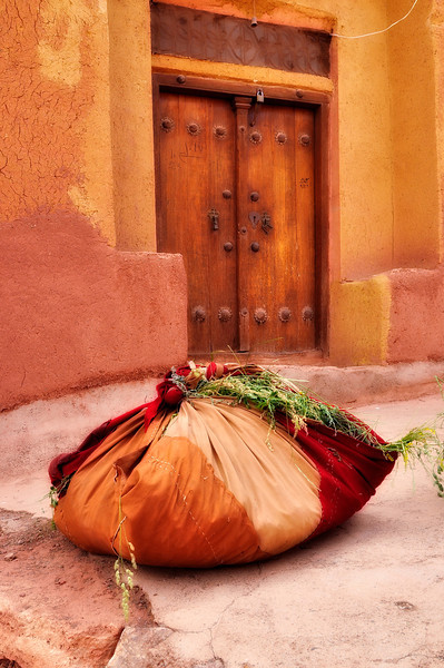 Wrapped fresh hay in front of an old house, Abyaneh, Iran.
