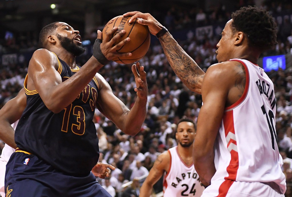 . Cleveland Cavaliers centre Tristan Thompson (13) and Toronto Raptors guard DeMar DeRozan (10) battle for the ball during the second half of Game 3 of an NBA basketball second-round playoff series in Toronto on Friday, May 5, 2017. (Frank Gunn/The Canadian Press via AP)