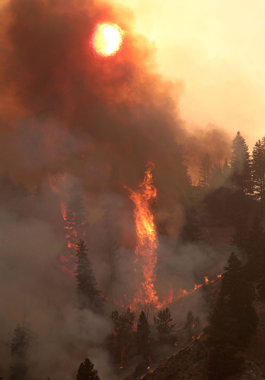 . Fire descends a ridge towards homes on the more than 90,000-acre Elk Complex Fire near Pine, Idaho, on Monday Aug. 12, 2013.   (AP Photo/Times-News, Ashley Smith)