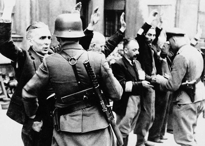 . Nazis arrest citizens in the Warsaw Ghetto, Poland, spring 1943. (AP Photo)