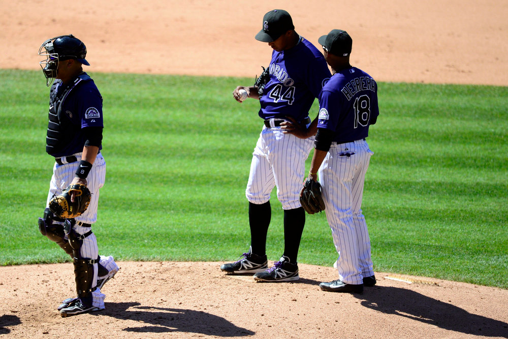 . Colorado Rockies starting pitcher Juan Nicasio (44) reacts after giving up a sixth inning no-hitter on a two-run home run by San Diego Padres catcher Nick Hundley (4) during the action in Denver. The Colorado Rockies hosted the San Diego Padres at Coors Field on Sunday, June 9, 2013. (Photo by AAron Ontiveroz/The Denver Post)