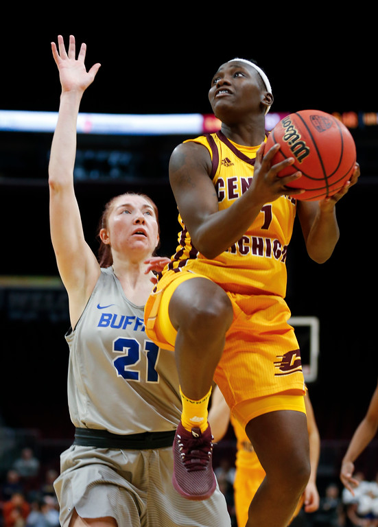. Central Michigan guard Micaela Kelly scores past Buffalo forward Mariah Suchan during the second half of an NCAA college basketball game in the championship of the Mid-American Conference tournament Saturday, March 10, 2018, in Cleveland. Central Michigan won 96-91. (AP Photo/Ron Schwane)