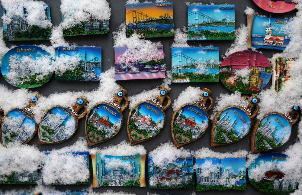 . Istanbul themed magnets are covered by snow as they are displayed for sale outside of a shop in Istanbul January 8, 2013. REUTERS/Murad Sezer