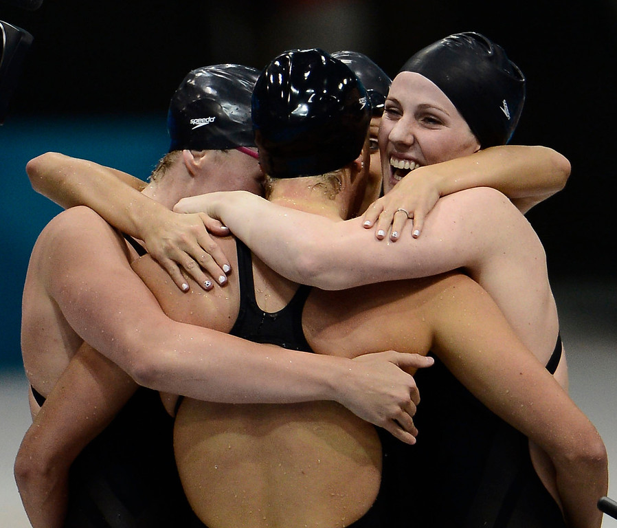 . Shannon Vreeland, Dana Volmer and Missy Franklin surround Allison Schmitt as the celebrate their win the women\'s 4 x 200m freestyle relay during the London 2012 Sumer Games. The team posted an Olympic Record with a time of 7:42.92 to capture the gold medal  John Leyba, The Denver Post