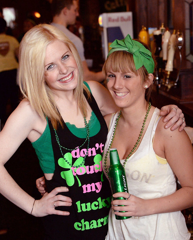 . Bartenders Ciara Wadding, 24, left, and Victoria Roehm, 21, pose for a photograph at Molly Branigans, an Irish-themed restaurant in Erie, Pa., on Monday, March 17, 2014. (AP Photo/Erie Times-News, Greg Wohlford)