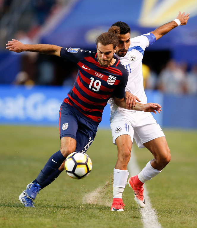 . United States\' Graham Zusi (19) controls the ball against Nicaragua\'s Juan Barrera (11) during a CONCACAF Gold Cup soccer match in Cleveland, Ohio, Saturday, July 15, 2017. (AP Photo/Ron Schwane)