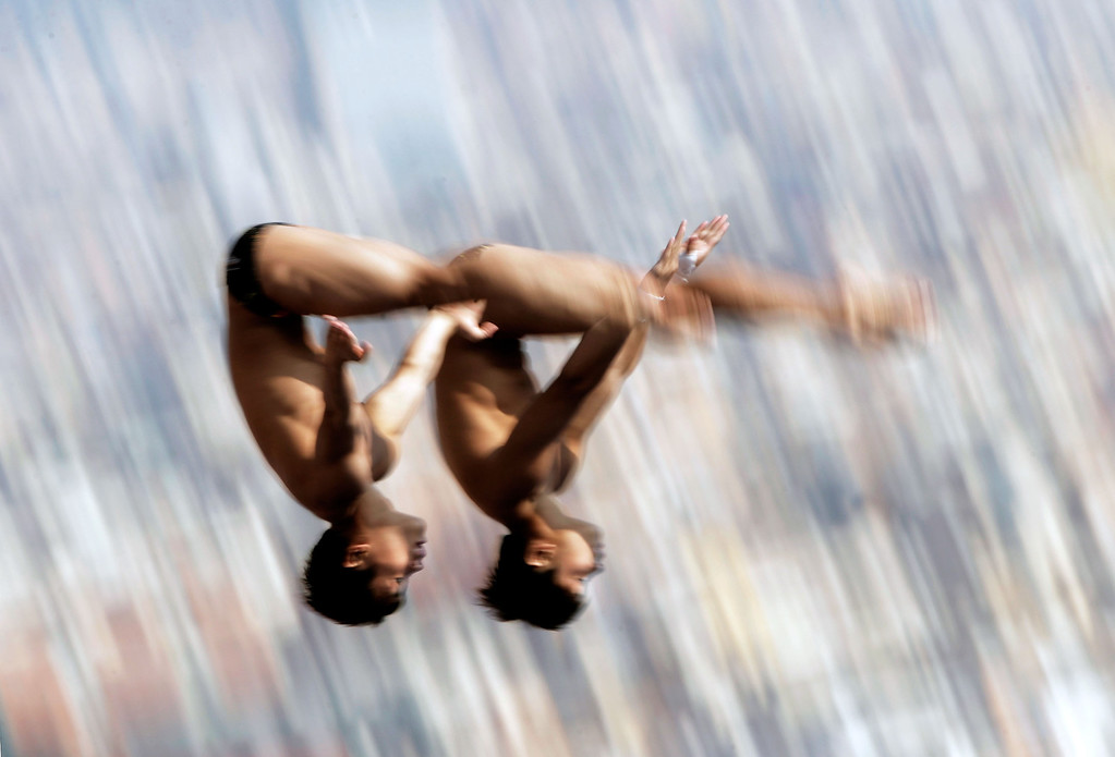 . Yuan Cao and Yanguan Zhang of China competes in the Men\'s 10m Platform Synchronised Diving preliminary round on day two of the 15th FINA World Championships at Piscina Municipal de Montjuic on July 21, 2013 in Barcelona, Spain.  (Photo by Adam Pretty/Getty Images)