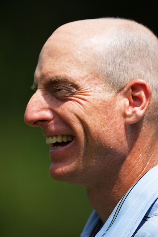 . ROCHESTER, NY - AUGUST 08:  Jim Furyk of the United States smiles on the ninth green after his five-under par 65  during the first round of the 95th PGA Championship on August 8, 2013 in Rochester, New York.  (Photo by Stuart Franklin/Getty Images)
