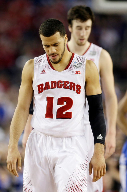 . Wisconsin guard Traevon Jackson (12) winces after a play against Kentucky during the second half of the NCAA Final Four tournament college basketball semifinal game Saturday, April 5, 2014, in Arlington, Texas. (AP Photo/David J. Phillip)
