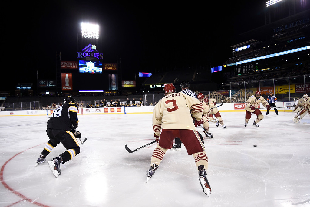 . Denver Pioneers and Colorado College during a face-off in the second period during the Battle On Blake February 20, 2016 at Coors Field.  (Photo By John Leyba/The Denver Post)